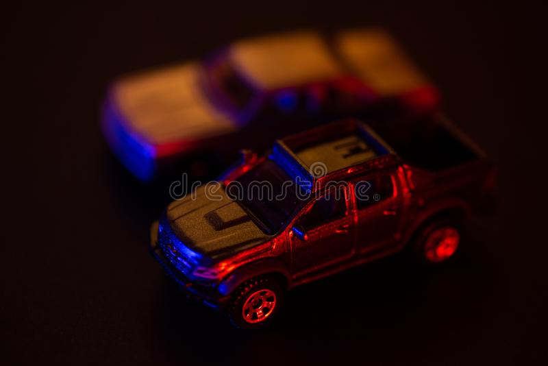 Toy cars under red and blue light stock photo