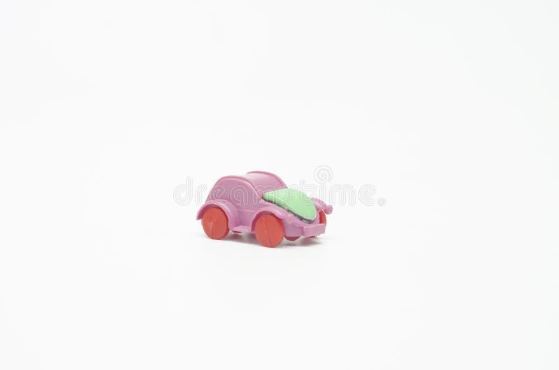 Toy Cart rosa su fondo bianco fotografia stock libera da diritti