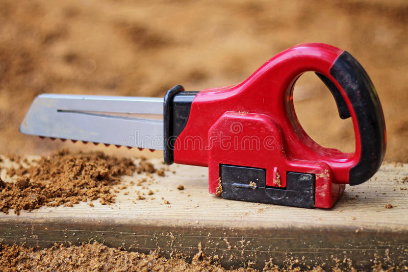 Toy Chain Saw. In the sandbox royalty free stock image