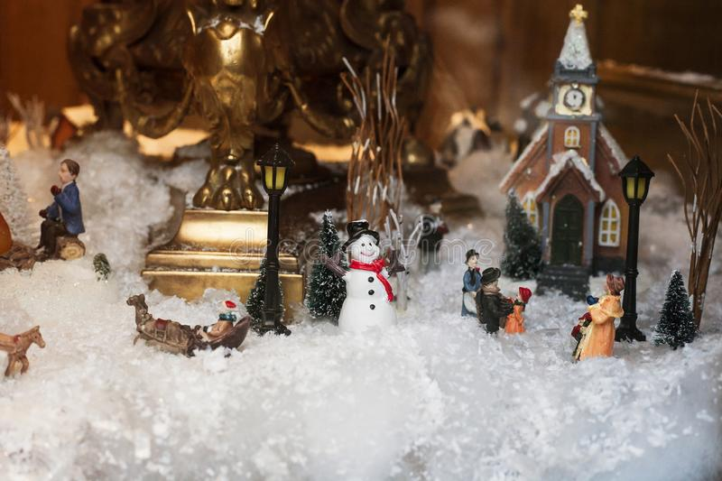 Toy Christmas ceramic miniature with snow-covered city royalty free stock photo