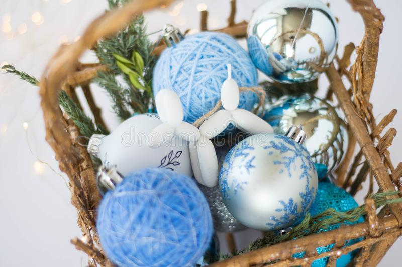 Toy for the Christmas tree in the form of a dog lies on a background of blue Christmas balls. 3d toys. 2020. toy for the Christmas tree in the form of a dog lies stock photos
