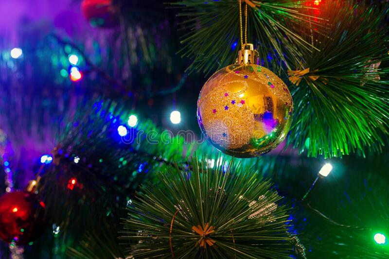 Toy on a Christmas tree. / new year mood background photo stock photo