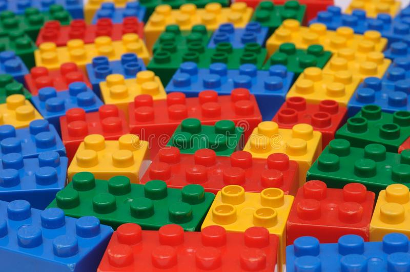 A toy construction set with many colorful building pieces. A photo taken on many toy construction set with colorful building pieces spread out. Shown are blue royalty free stock image