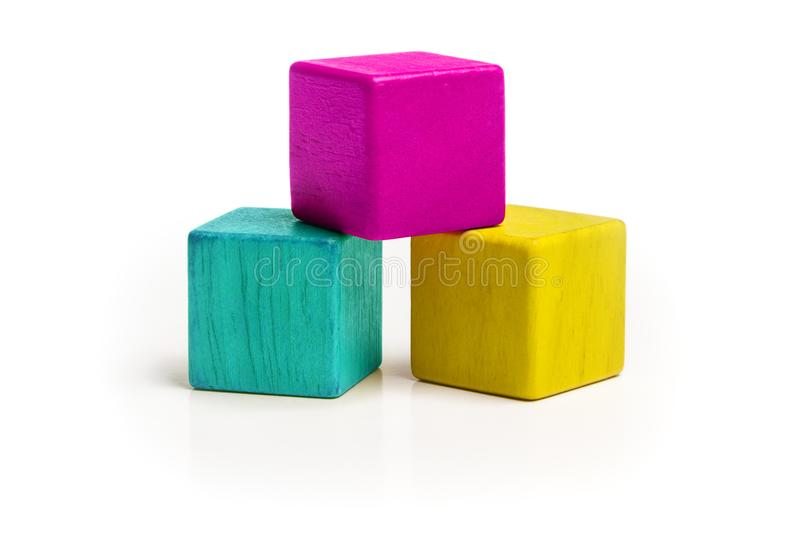 Toy Cube Blocks, CMYK Color Isolated over White Background. Three Kids Wood Toys, Cyan Magenta Yellow colors royalty free stock photography