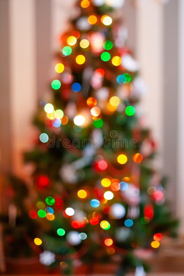 Toy for the decoration for Christmas tree. Lights and bokke on the background.  royalty free stock photos