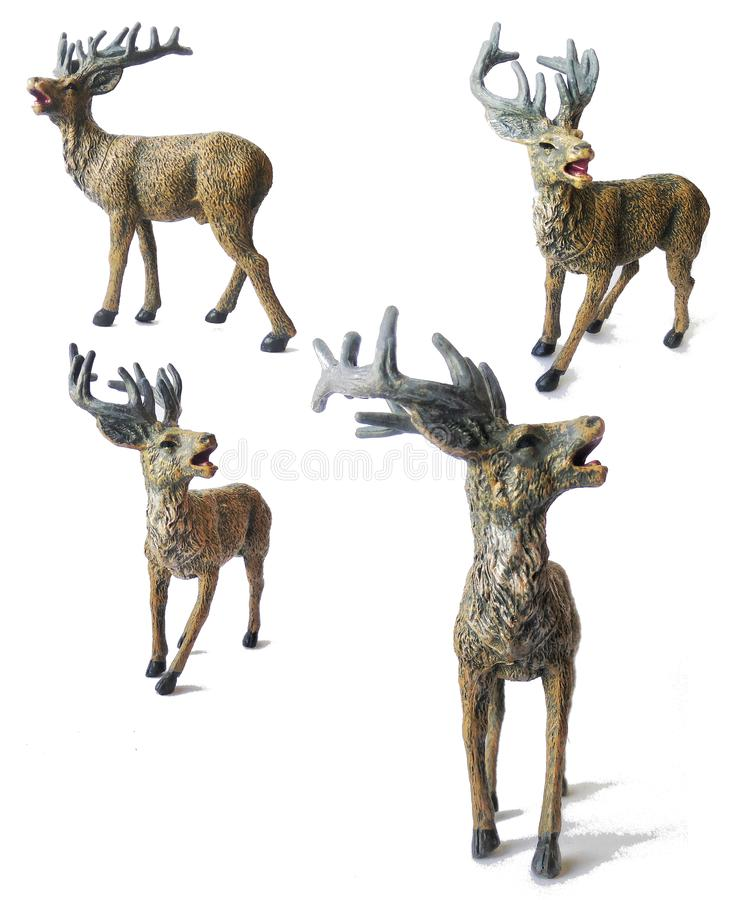 Toy deer and reindeer. Toy deer. Small plastic kids toy deer with great horns. Model of Stag or red deer or reindeer. Isolated on white background. Different royalty free stock photos