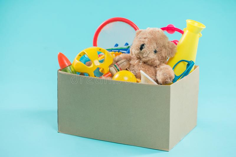 Toy. Donation box with unwanted items for poor.  stock photo
