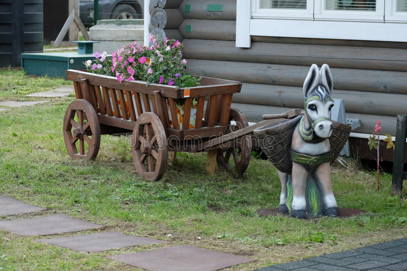 A toy donkey with wooden cart royalty free stock images