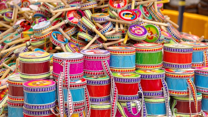 Toy drums. Heap of toy drums on a table in the Artisan`s Market in Otavalo, Ecuador stock photos