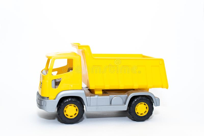 A toy dump truck isolated against a white background royalty free stock photography
