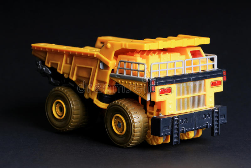 Toy Dump truck. Over black background stock image