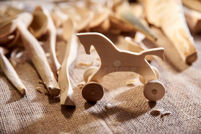 Toy figurine horse carved in wood, a carpenter in workshop. Toy figurine horse carved in wood, a carpenter in the workshop royalty free stock photos