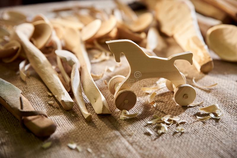 Toy figurine horse carved in wood, a carpenter in workshop. Toy figurine horse carved in wood, a carpenter in the workshop royalty free stock images