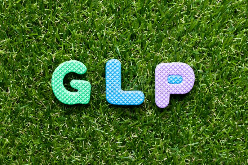 Toy letter in word GLP Abbreviation of Good laboratory practice on green grass background. Toy foam letter in word GLP Abbreviation of Good laboratory practice stock images