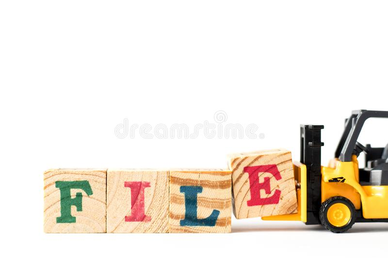 Toy forklift hold block e to complete word file on white background. Toy forklift hold letter block e to complete word file on white background royalty free stock image