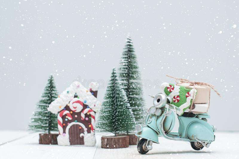 Toy gingerbread house in christmas trees town and motorbike wit royalty free stock photo