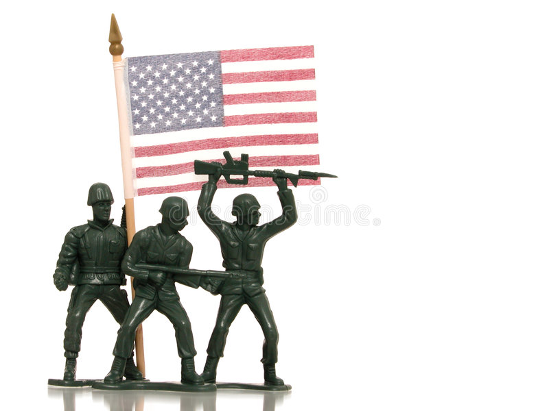 Toy Green Army Men with US Flag on White. Green army men holding a US Flag on white with reflection royalty free stock photos