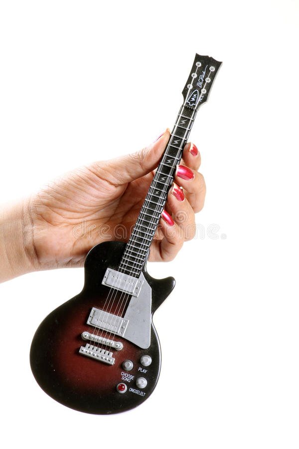 Download Toy guitar stock photo. Image of concept, white, hand - 28106720