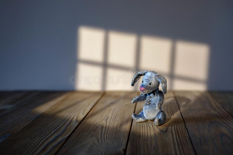 Toy hare natural background the shadow of the window royalty free stock photo