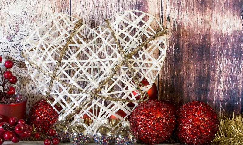 Toy heart with Christmas balls stock photo