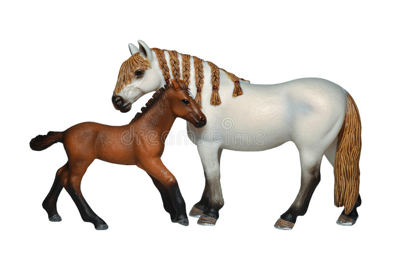 Toy horse and foal. Isolated on white stock photos