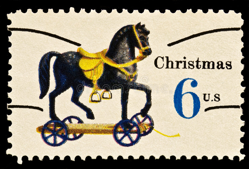 Toy horse on wheels Christmas Stamp royalty free stock image