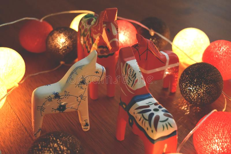 Toy horses and Christmas decorations stock photography