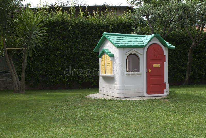 Toy house. In the garden stock photos