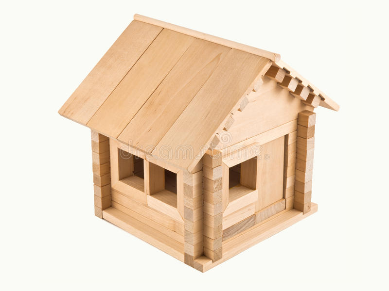Toy house. Wooden toy house. Isolated on white background stock image