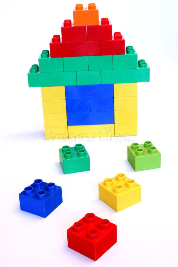 Toy house. Built by using colorful building blocks stock photo