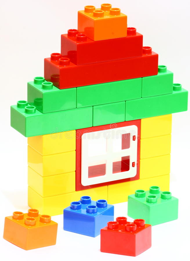 Toy house. Built by using colorful building blocks stock images