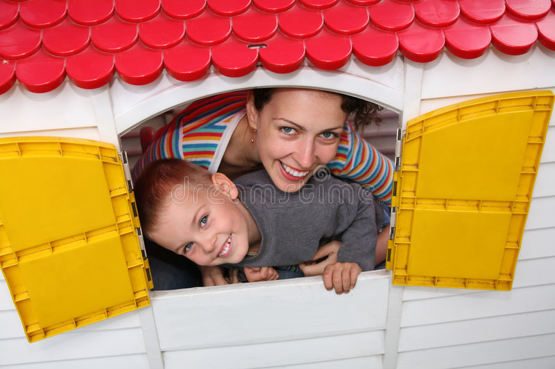In the toy house. Mother and son in the toy house royalty free stock photos