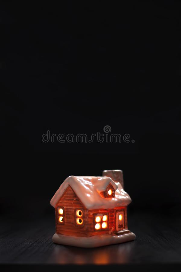 Toy house on a black background. Christmas, winter, new year, halloween concept. Copy space. Christmas composition. Toy house on a black background. Christmas stock photos
