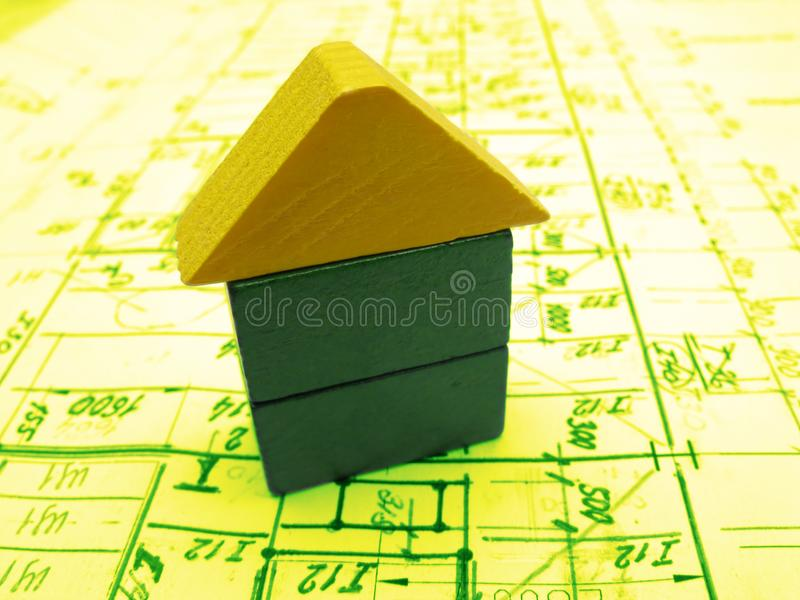 Toy house and drawings royalty free stock images