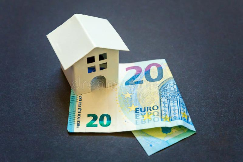 Toy House and euro. Euro banknotes and symbolic small toy house. Buying property and mortgage royalty free stock photos