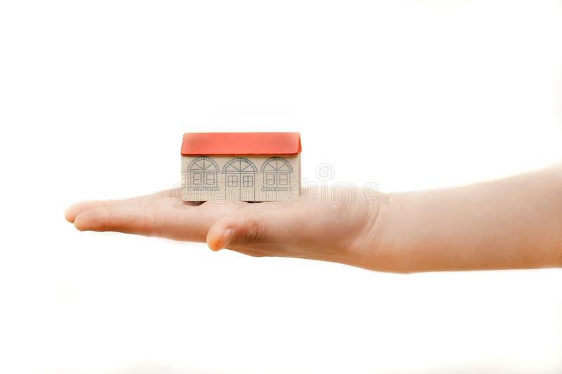 Toy house on hand royalty free stock image