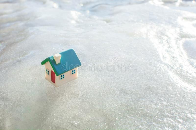 Toy house on ice stock images