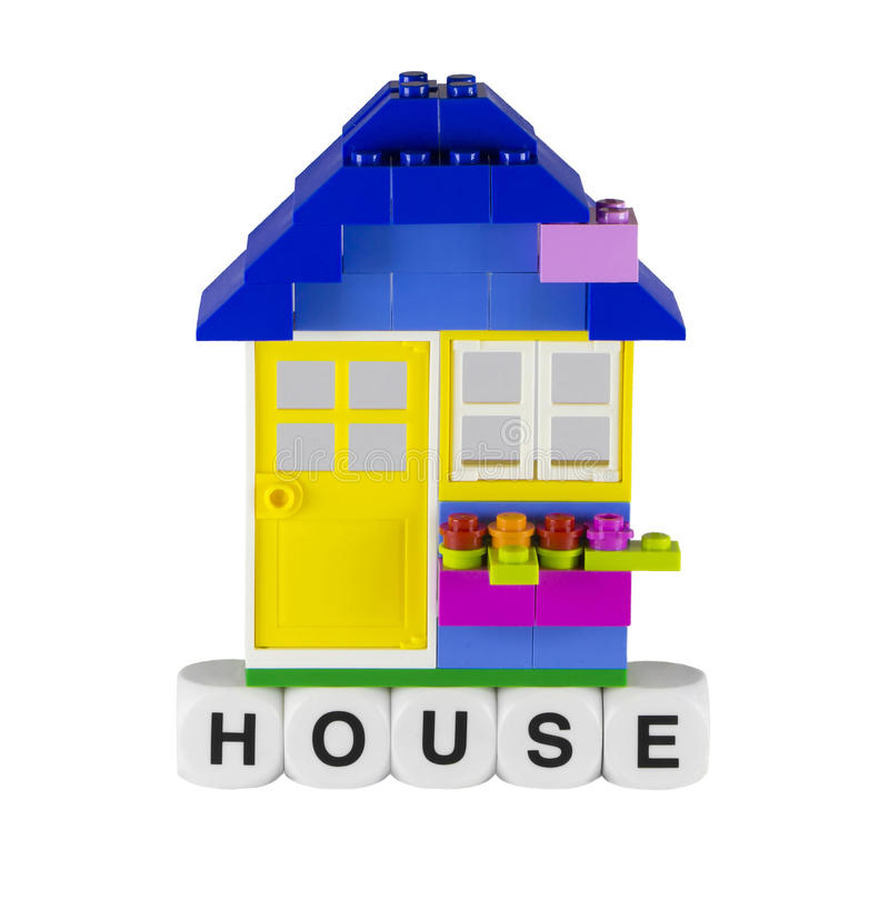 Toy house. A little toy house with yellow door royalty free stock image