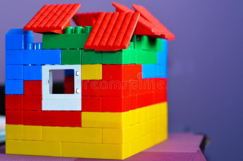 Toy house. Made from colorful bricks stock photos