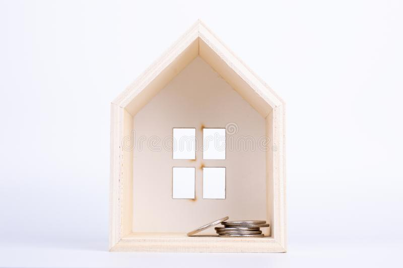 Toy house on the white background. Living object concept stock photo