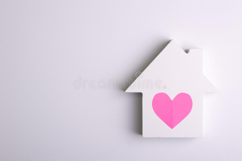Toy house on the white background. Living object concept royalty free stock photo