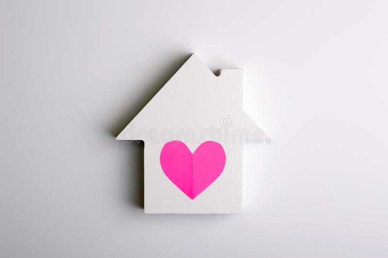 Toy house on the white background. Living object concept stock photos