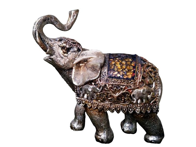 Toy Indian elephant with a raised trunk. An elephant with a raised trunk is a symbol of wealth and prosperity. Beautiful colorful toy Indian elephant on a royalty free stock photography