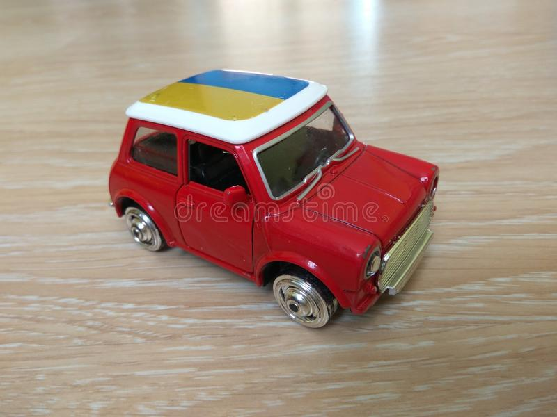 Toy red yellow blue metal car model. Toy for kids or collectors. Realistic Red metal car front view stock photo
