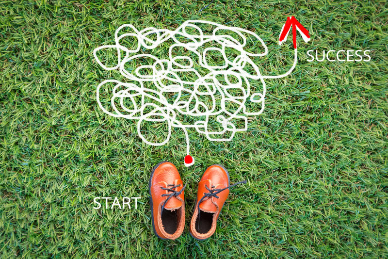 Toy leather shoe on grass field texture background. With copy-space stock images