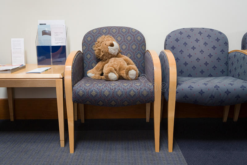 Toy lion in hospital waiting room royalty free stock photo