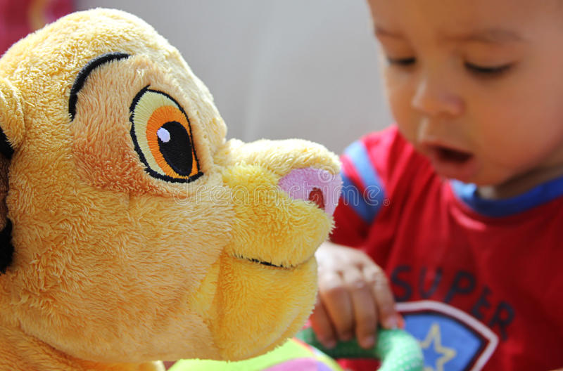 Toy lion with young boy royalty free stock images