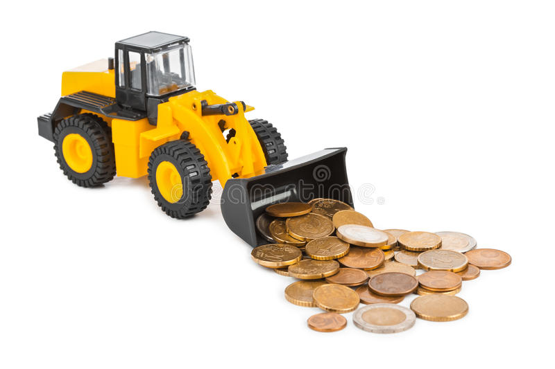 Toy loader and money coins. Isolated on white background royalty free stock image