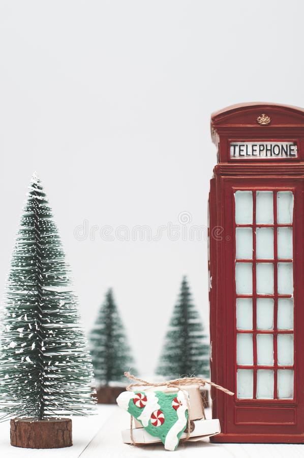 Toy London red phone booth, gifts and christmas trees stock image