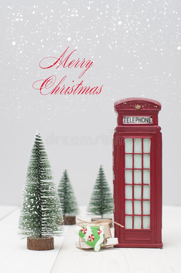 Toy London red phone booth, gifts and christmas trees royalty free stock photography